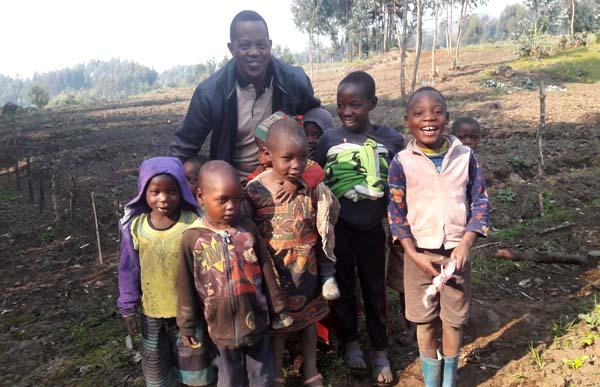 David Mugisha and children in Rwanda