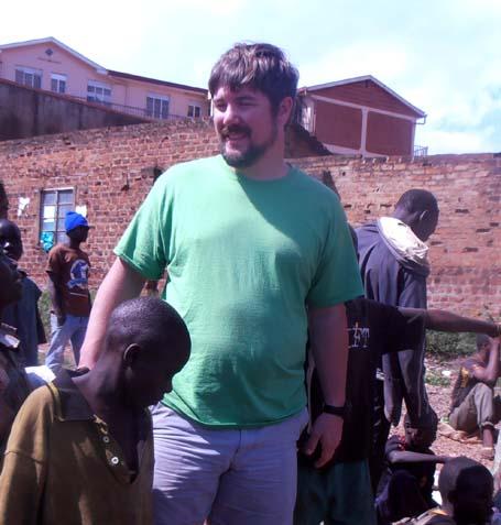 John Burns visiting a slum